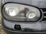 VW GOLF IV LAMPA PRAWA PRZÓD CIEMNA CZARNA