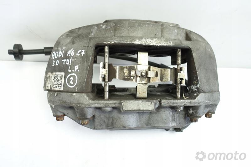Audi A6 C7 3.0 TDI PRZEDNI ZACISK HAMULCOWY lewy