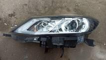 Nissan pulsar reflektor lewy UK 26060-3zp5a