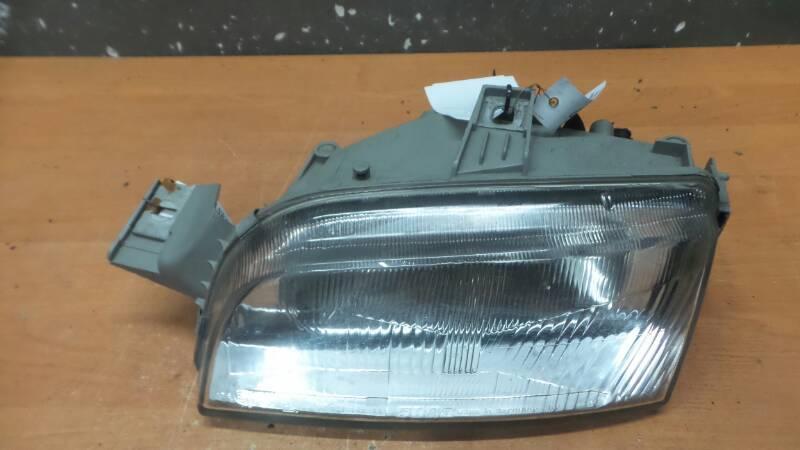 L142597-00 REFLEKTOR LEWY FIAT PUNTO I 1998r ELE.