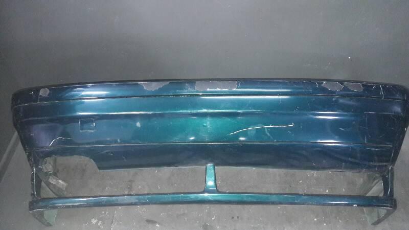 8146089 ZDERZAK TYLNY BMW E36 96r 4D ZIELONY