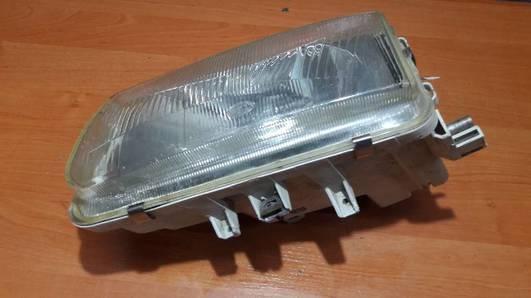 962495-00 REFLEKTOR LEWY HELLA VW POLO IV 97R